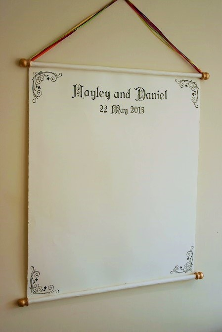 Handwritten scroll as a Wedding guest book alternative