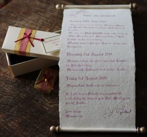 Handwritten letter scroll with pink ink